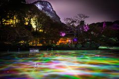 Different color of lights in the water pond at night at Mifuneyama Rakuen Garden in Saga, Japan. royalty free stock image