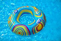 Colorful pool float in blue swimming basin royalty free stock image