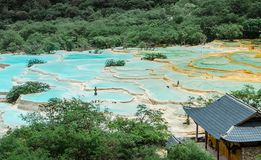 Colorful pool of Huang long. About 100 Km away from Jiuzhai Valley, Huanglong is famous for its wonderful fresh air and the colorful pool. The blue color is stock image