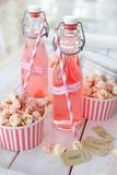 Colorful popcorn in striped cups Royalty Free Stock Image
