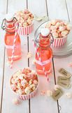 Colorful popcorn in striped cups Stock Photography
