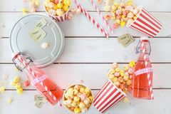 Colorful popcorn in striped cups Stock Images