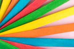 Colorful popsicle sticks background abstract minimal creative concept. Multicolored rainbow wooden popsicle sticks abstract stock photography