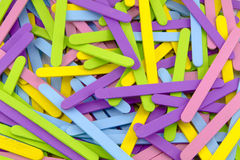 Colorful Popsicle Sticks. Scattered Colorful Popsicle Sticks Close Up royalty free stock photography