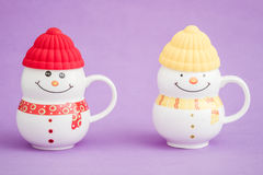 Colorful Porcelain Mug as Snowman on purple background, Stock Image