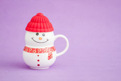 Colorful Porcelain Mug as Snowman on purple background, Royalty Free Stock Photography