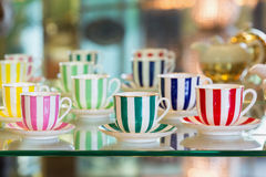 Colorful porcelain tea cups stock photos
