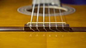 Colorful portrait of the bridge and the strings of an acoustic guitar. For musical themes background Stock Photo