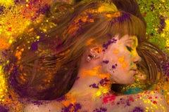Colorful portrait woman face in paint Stock Photos