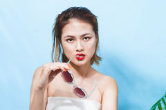 Colorful portrait of young attractive asian woman in sexy dress Royalty Free Stock Photo