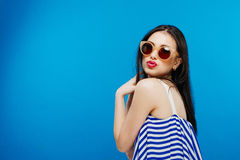 Colorful portrait of young attractive woman wearing sunglasses. Summer beauty and nail art concept stock photography