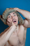Colorful portrait young glamour sportive hipster man keeps hands for head with crazy emotions Royalty Free Stock Photo