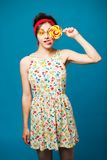 Colorful portrait  young sexy funny fashion girl posing on blue Royalty Free Stock Images