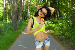 Colorful portrait of young funny fashion girl posing  in summer style outfit Royalty Free Stock Photos