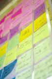 Colorful post it on glass wall Royalty Free Stock Photos