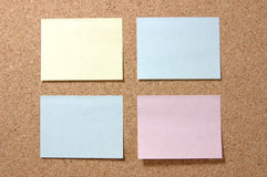 Colorful post-it notes on corkboard Royalty Free Stock Image