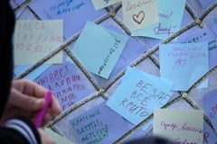 Colorful Post It Notes with suggestions on the walls at the Art and Culture Center on . Russia Berezniki 26 may 2019.  stock image