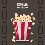 Colorful poster of cinema time with film tape in background and popcorn pack in closeup. Vector illustration Royalty Free Stock Photography