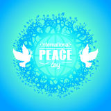 Colorful poster for International peace day. Two doves, and the inscription on the background of the globe Stock Image