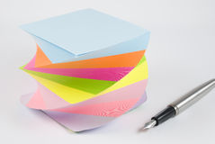 Colorful postit sticky notes. With pen studio isolated on white background Stock Photos