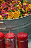 Colorful potpourri and red candles Royalty Free Stock Images