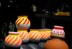 Colorful Pots In Market. Beautiful colorful pots in sun light Royalty Free Stock Image
