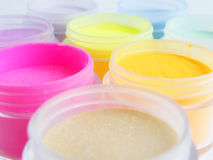 Colorful pots of paint. Abstract background of colorful pots of paint or cosmetics Stock Photo