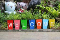 Colorful pots and painting welcome word- garden decoration royalty free stock photos