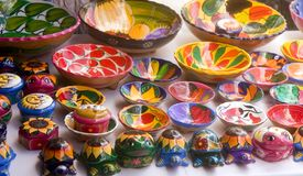Colorful Pottery. A display of colorful pottery and figurines at a Mexican flea market Royalty Free Stock Photo