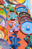 Colorful pottery. Colorful art pottery plates and gecko lizards Royalty Free Stock Photo
