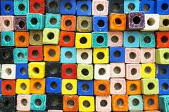 Colorful pottery in square shape with the hole inside Royalty Free Stock Photo