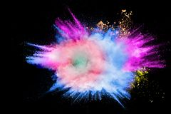 Colorful powder explosion in Happy Holi Festival. Multicolored dust particle splashing royalty free stock photography