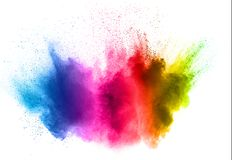 Colorful powder explosion on white background. Abstract pastel color dust particles splash.  royalty free stock images