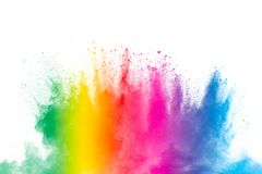 Colorful powder explosion on white background. Abstract pastel color dust particles splash.  stock photos