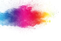 Colorful powder explosion on white background. Pastel color dust particle splashing.  royalty free stock photo
