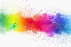 Colorful powder explosion on white background. Pastel color dust particle splashing.  stock image