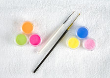 Colorful powder for nails and  brushes Stock Photos