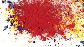 Colorful powder paint on of milk. Media. Chemical reaction of paint rejection from drop of substance on liquid surface