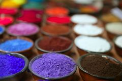 Colorful powder pigments in rows. In clay bowls Royalty Free Stock Photo