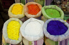 Colorful Powder Pigments. Various colorful dry pigments, placed in sacks. Closeup outdoor shot Royalty Free Stock Image