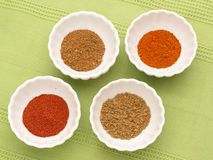 Colorful powdered spices in white bowls Stock Photo
