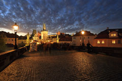 Colorful Prague gothic Castle with St. Nicholas' Cathedral and Bridge Tower from Charles Bridge above the River Vltava after Sunse Royalty Free Stock Photo
