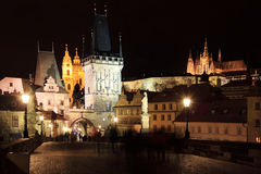 Colorful Prague gothic Castle with St. Nicholas' Cathedral from Charles Bridge above the River Vltava in the Night Royalty Free Stock Images