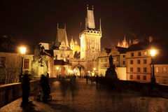 Colorful Prague gothic Castle with St. Nicholas' Cathedral from Charles Bridge above the River Vltava in the Night Stock Photo