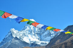 Colorful prayer flags and  Ama Dablam Royalty Free Stock Images