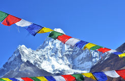 Colorful prayer flags and  Ama Dablam Royalty Free Stock Photos
