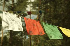 Colorful prayer flags lungta/darcho of Buddhist philosophy. In the wind. Soft focus with bokeh stock photography