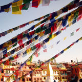 Colorful praying flags on the Boudhanath Stupa - vintage filter. Stock Photo