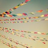 Colorful praying flags near Boudhanath Stupa - vintage filter. Royalty Free Stock Image