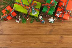 Colorful present boxes for any holiday on wooden background Stock Images